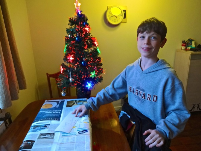 Alex calmly prepares to open an early Christmas present before our trip to Thailand.