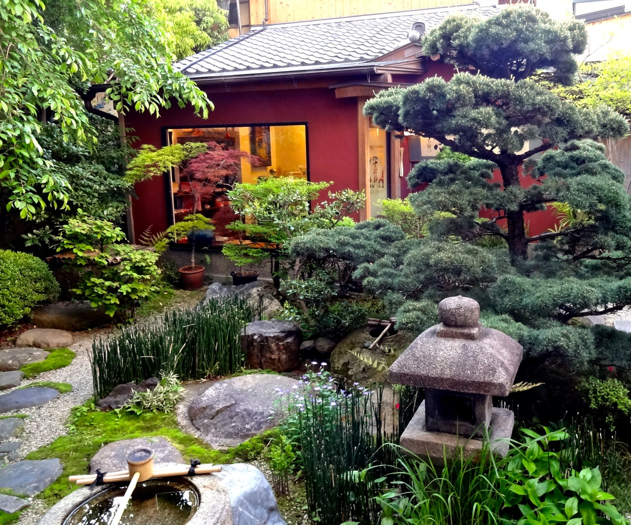 meandering paths stone lantern water basin koi pond rocks flowers and