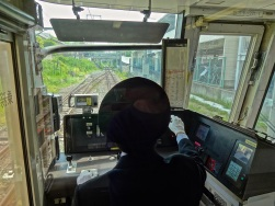 The view looking out the front of a Japan Rail train heading to Nara from Kyoto main station. White-gloved and uniformed engineers keep precise timing to ensure arriving to the next station on the minute it is due.