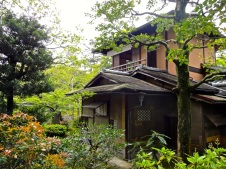 A traditional Japanese home is engulfed by Spring flowers and trees in Kyoto. Large or small, homes in Japan make good use of the natural world outside the door.