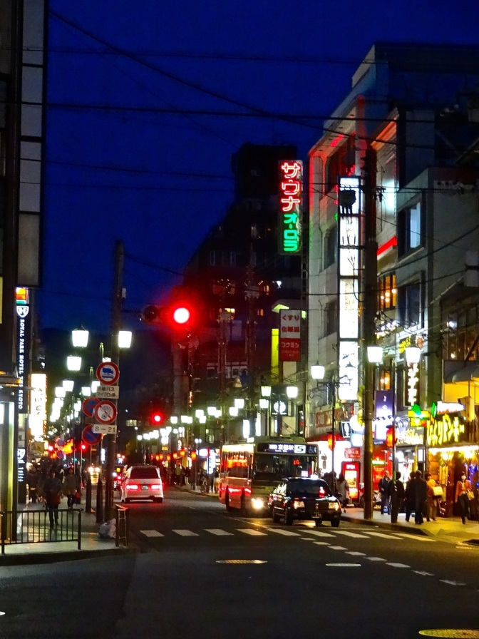 Despite 1,600 ancient temples and shrines,  Kyoto lights up after dark.  Looking east down Sanjo St. toward the Kamo River.