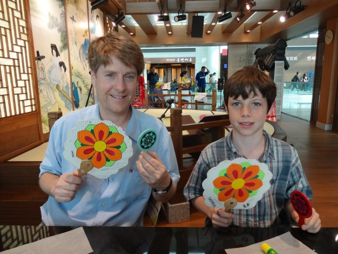 Alex and dad fan our still wet hand mirrors covered thin colored paper and shellacked to seal in the delicate paper.