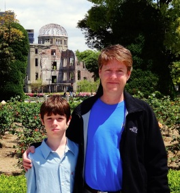 Alex and dad stand in front of the A-Bomb Dome in Hiroshima, Japan.