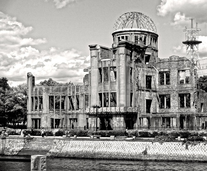 The building known as the A Bomb Dome, from across the river in the Hiroshima Peace Park. The building, one of the few survivors  of the world's first  atomic bomb used on civilians, is a silent reminder of 8:15 am, August 6, 1945.