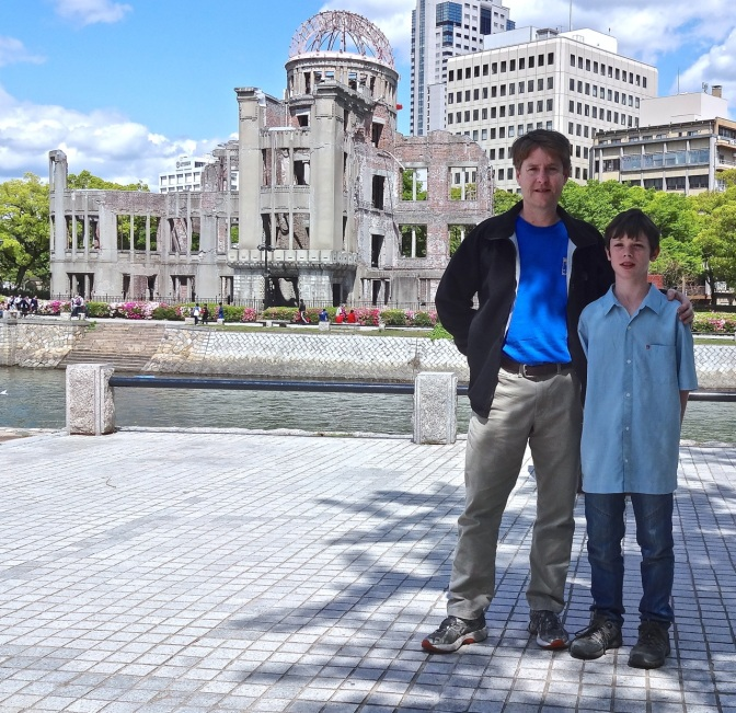 Kevin and Alex standing in the Hiroshima Peace Park,  just across  the river from the A-Bomb Dome.