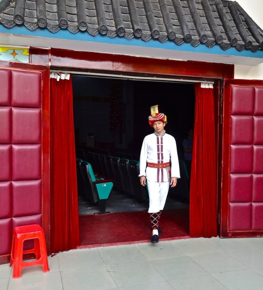 A performer in  Guilin wears his traditional costume just before a performance of local music and dance.