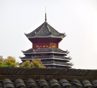 A traditional drum tower looms over a city park in Guilin. The towers served as a way to both tell time and to warn citizens of invading armies or natural disaster.