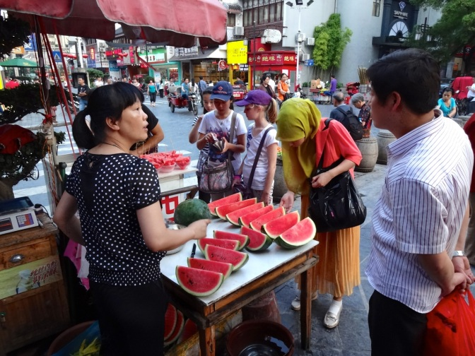 Fresh-cut watermelons at tje night markets in Guilin. Local markets at dusk is a nightly tradition all across Asia.