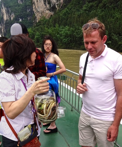 Qingdao teacher, Chris Cronin is less than enthusiastic to the suggestion that he try a glass of the local spirit: Snake wine.