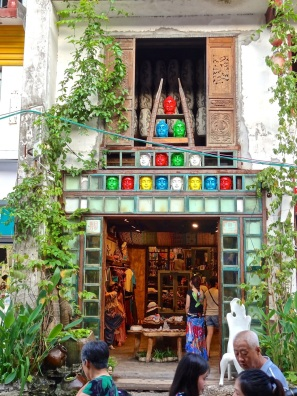 Colorful Buddha heads form a pyramid above the door of this West Street shop in Yangshuo.
