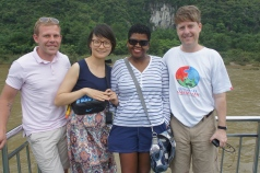 A gaggle of teachers line up for the customary group picture aboard the slow boat down the Li River in southeastern China.