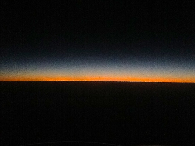 On a return trip to China from Laos, I took this shot out of the window as the sun slipped away in the west.