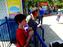 Alex prepares to claim his seat on the Swing Chairs ride.