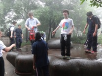 Alex and a group of boys explore the iron-top lookouts on the best preserved battery from the German occupation of Qingdao before and during the Great War.