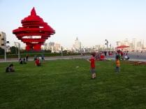 Alex flies a kite at Qingdao's May 4 Square.