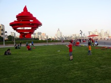 Alex flies a kite at Qingdao's May 4 Square.