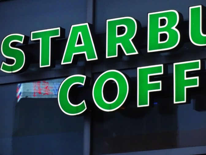 The familiar glow of a Starbucks sign lights up at Marina City. Despite China's preference for tea, many young people now include coffee in their daily routines.