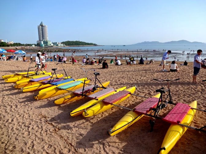 Beach #1 in Qingdao is described as 'cleanish' and features pontoon and jetski rentals, food options, and great views of the Yellow Sea and the sea islands off China.