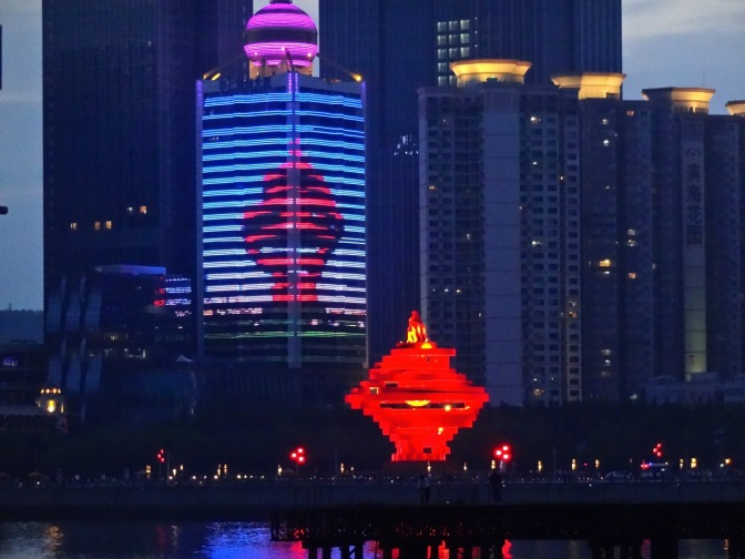"""The Wind of May"", weighing in at over 700 tons of steel, looks spectacular lit up at night in Qingdao's May 4th Square."