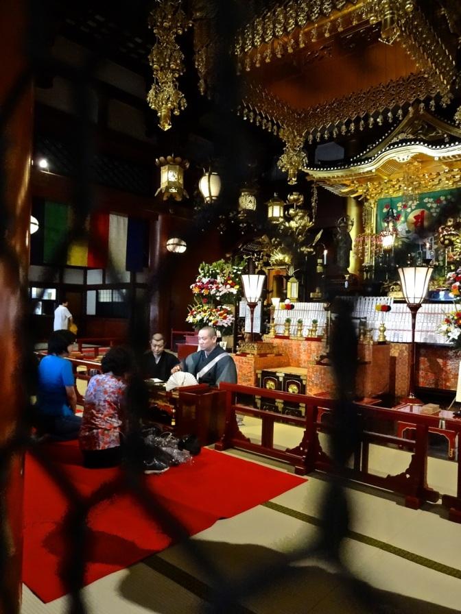 A peek toward the altar inside the main Buddhist temple at at Senso ji temple in Tokyo