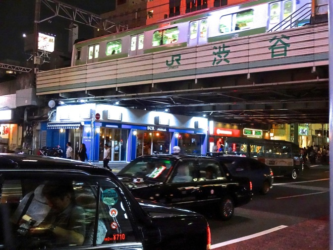 Cabs line up outside the world's busiest train station-Shibuya in western Tokyo.  The JR line travels in all directions with both subways and high speed and local trains.