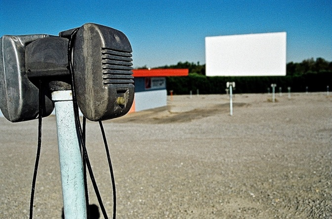 Although many drive ins have gone to using the FM radio in the car to hear the movie, some still use the ages-old mono speaker that fits on your window sill.  More than a few folks have accidentally driven off with the movie speaker still attached to their car at the end of the night.