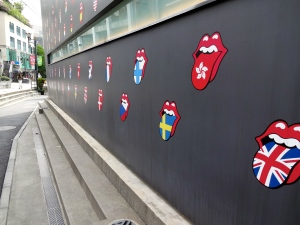 The Rolling Stones logos adorn a neighborhood wall.