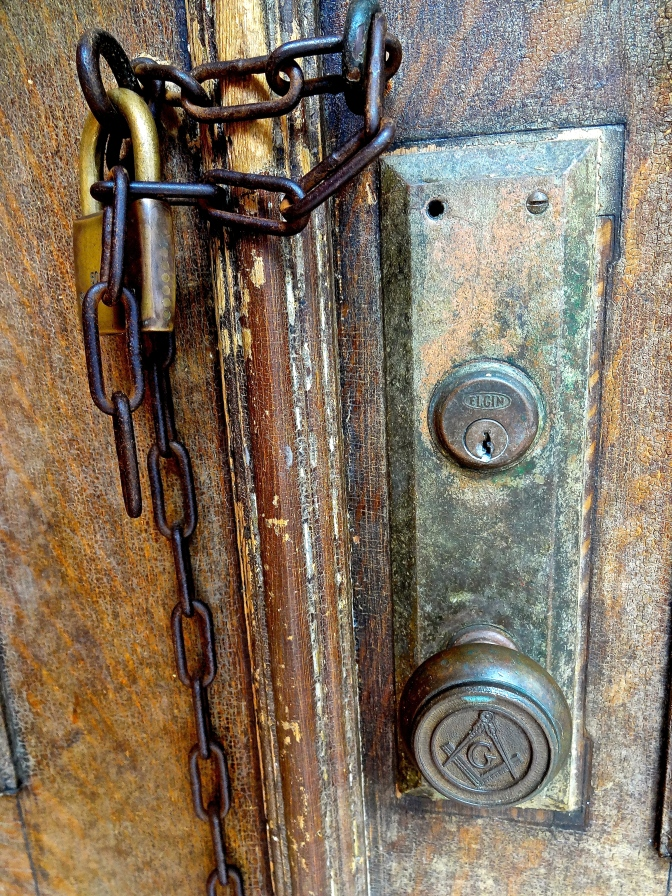 Weathered doors and locks on an old and abandoned shop near Cat Street reveal  their own story.