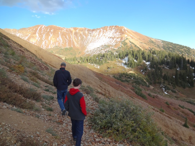 Alex and John, an old high school pal, and full-time CB resident  hike near Gothic Mountain through snow patches and remnants trails recently blown down the mountainside by torrents of unusual September rainstorms.