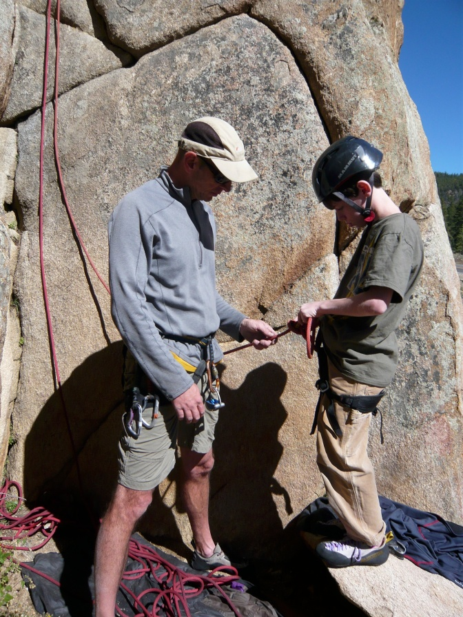 John gives Alex a lesson in rock climbing near Taylor Canyon and Spring Creek on the way to Independence Pass.  A natural climber, Alex took right to the cliff and scrambled up without a problem.