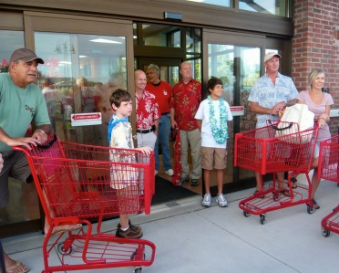 The grand opening of Charleston's firstTrader Joe's in 2011.  Alex, left filtered to the front of the line, bolted through the store to make the store's first official sale: Triple Ginger Snaps.