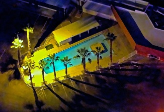 From high above, a swimming pool at night in Las Vegas, glows under the sodium lights.